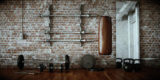 Old-fashioned gym with weights and bars