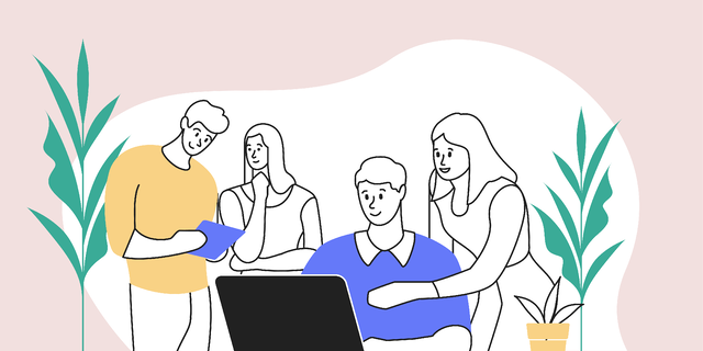 people by a laptop (how to optimise your marketing team for long-term flexible working)