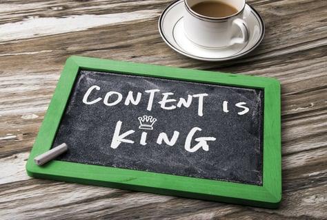Content is king written on a slate board