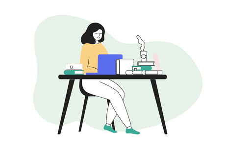 Distraction free writing - woman writing at a desk