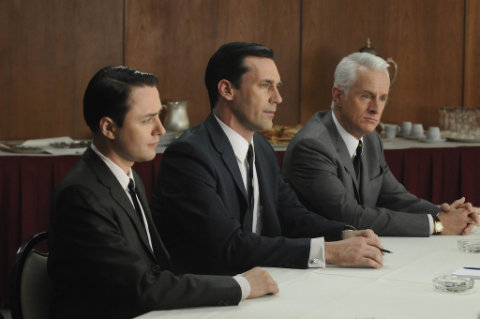 """Man in the mirror: Pete Campbell, from left, Don Draper and Roger Sterling are shown during a scene in popular TV series, """"Mad Men"""". (MCT)"""