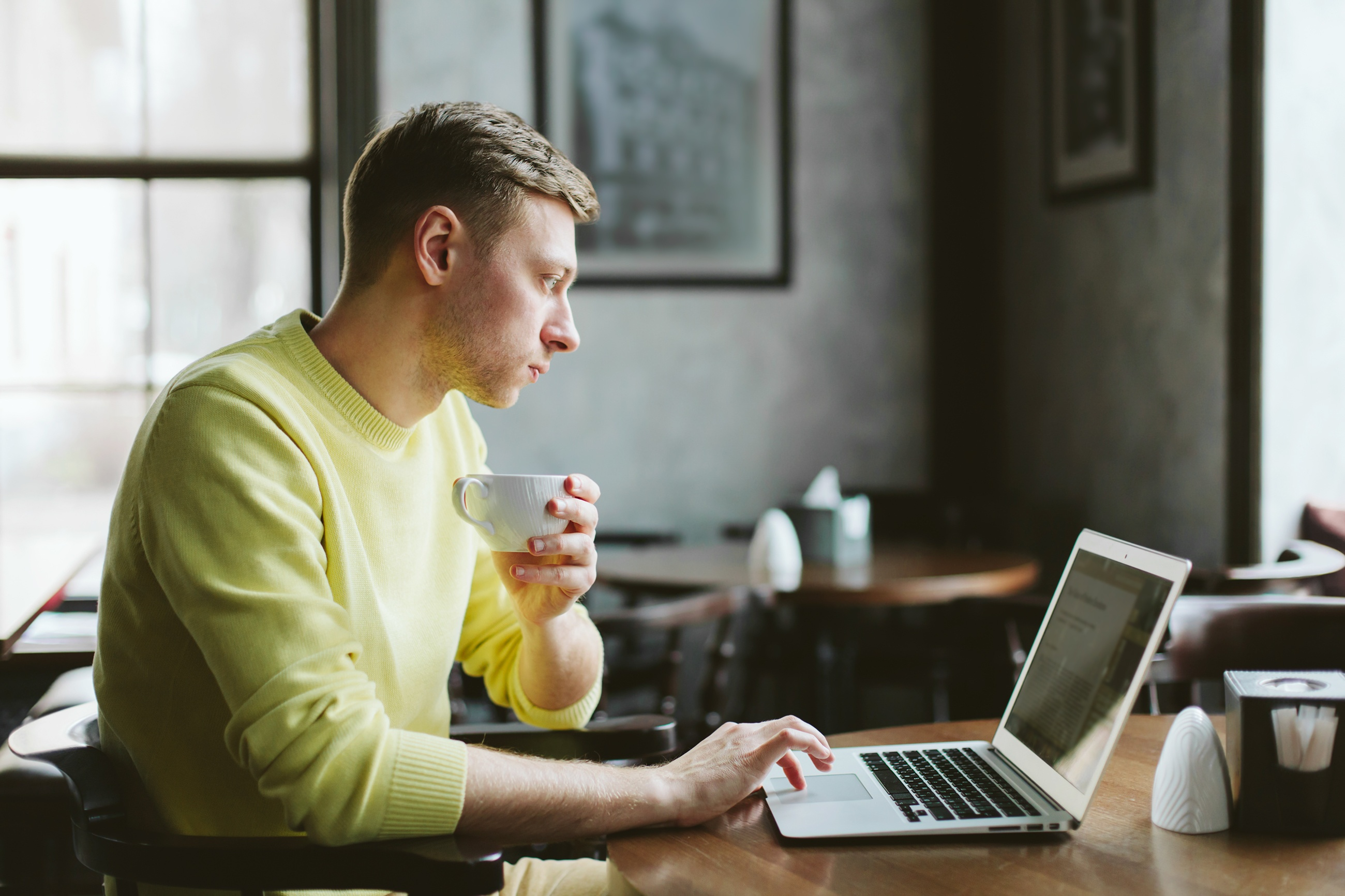 Man writing on a laptop illustrating the concept of creating great content for SEO