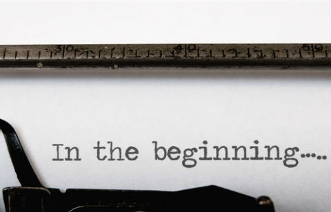 Typewritten text that says 'in the beginning'