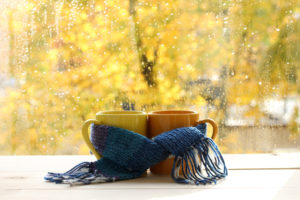 Create warm leads for your salespeople. Image shows two mugs tied together by a scarf.