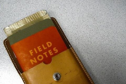 Notebook that reads Field Notes on the front cover re freelance writer