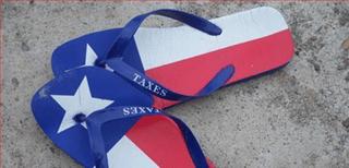 Sandles in Texas colour scheme that say 'taxes' instead