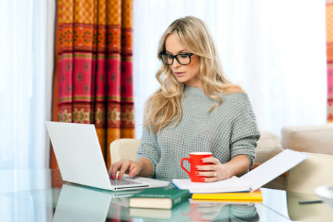 what does a copywriter do: woman at desk with books