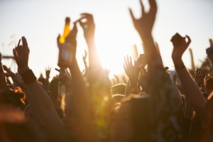 strengthen brand value: fans with arms in the air