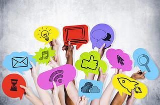 Social media success with hands holding cards