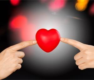 Marketing mojo: two hands touching a heart