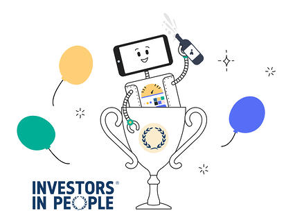 Announcing Articulate Marketing has achieved a 'We invest in people (Silver)' certification - Artie the Articulate robot sitting in a trophy celebrating with a bottle of red, alongside the Investors in People logo, with balloons in the background