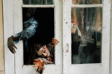 Zombies coming through a door