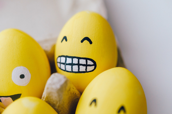 Smiling emojis on eggs